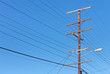 Telephone utility pole, cables, clear blue sky - 60084059