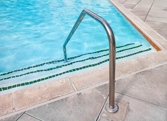 Swimming pool handrail at shallow end