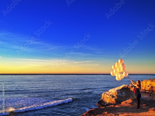 Woman with Balloons at Sunset Cliffs Point Loma California USA