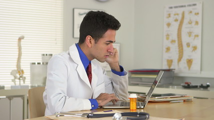 Doctor talking on phone at desk