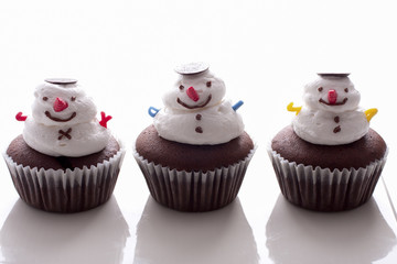 Snowman cupcake on white background