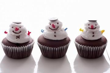 Snowman cupcake on white background