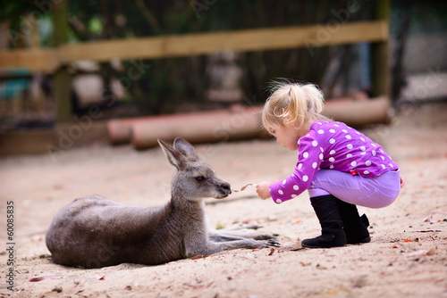 Deurstickers Kangoeroe young girl and kangaroo in the zoo