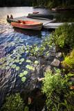 Rowboat at lake shore at dusk