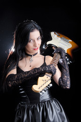 Goth Woman Holding Electric Guitar