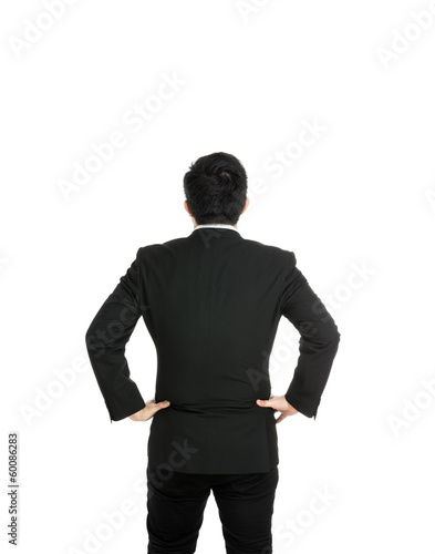 Back view with businessman hand on hip
