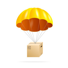 Yellow parachute with cardboard box on a white