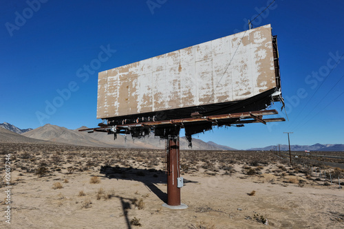 Old rusted blank billboard by road