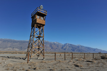 Wooden guard tower in desert by mountains