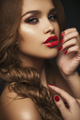Sexy Beauty Girl with Red Lips and Nails. Provocative Make up. L
