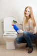long-haired housewife cleaning toilet