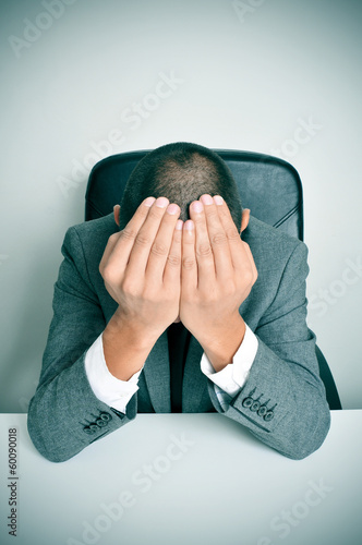 businessman with his hands in his head