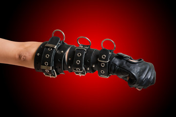 Fist in leather glove