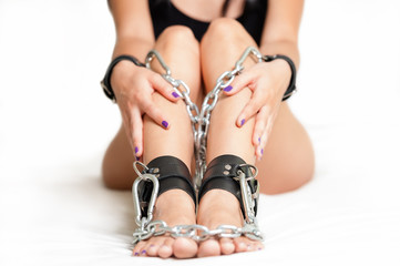 Legs in shackles