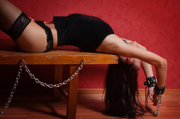 Slave girl laying on bench