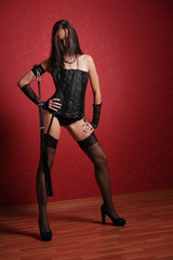 Young Mistress in Corset on Red