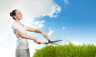 Woman cutting lawn