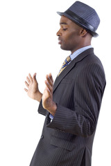 young black businessman in a retreating or defensive gesture