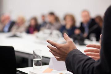 man having presentation at seminar