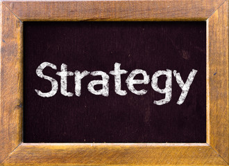 Strategy handwritten with white chalk on a blackboard