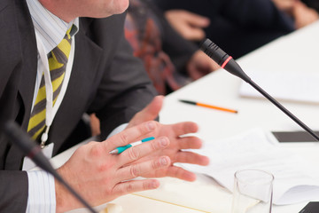 gesturing hands at business meeting