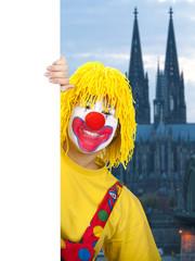 Clown mit Schild in Köln