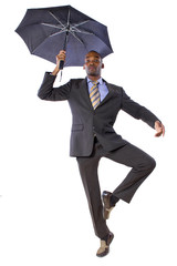 young black businessman dancing with an umbrella