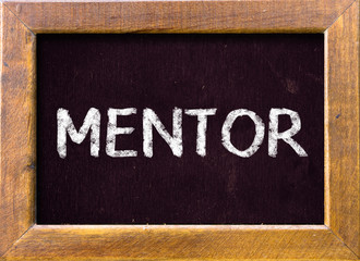 Mentor word written on a chalkboard