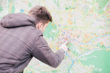 Tourist looking for directions on city map