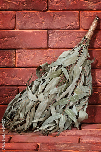 Eucalyptus broom for a bath on a stone surface.