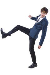 young caucasian businessman kicking pose on white background