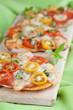 Mini pizzas with mozzarella, cherry tomatoes and basil