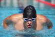 Close up of swimmer  Man swimming butterfly strokes