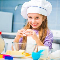 Cute little girl preparing cookies