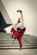 Hip Hop street dancer one hand stand