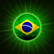 football with Brazilian flag over green rays