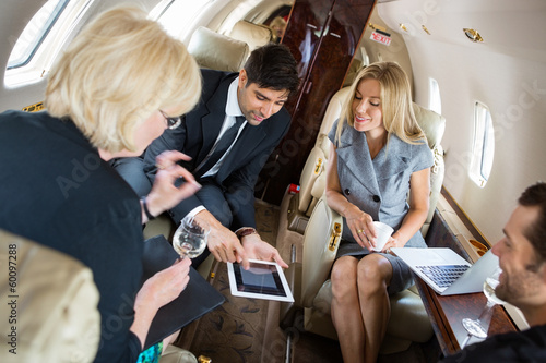 Business People Meeting In Private Jet - 60097288
