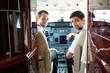 Pilots In Corporate Plane Cockpit