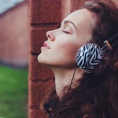 girl with headphones, closeup face