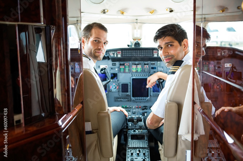 Pilots In Corporate Plane Cockpit