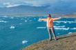 Woman watching icebergs. Iceland