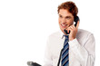 Young professional answering phone call