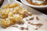 ravioli and white meat sauce with shallow depth of field