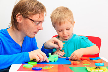 father and son playing with clay dough