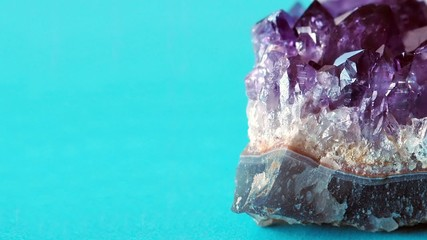 Purple crystal amethyst on blue background