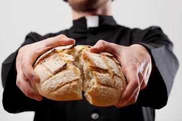 Symbol of Communion breaking bread
