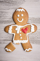 Gingerbread man with red heart and broken leg