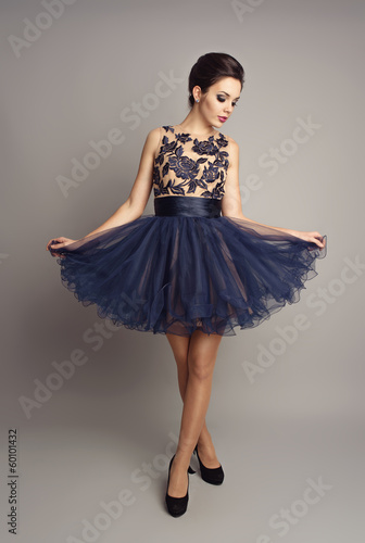 Pretty girl in ballerina pose in beautiful fashionable dress