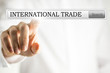 Hand clicking to search for international trade