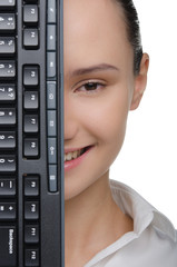 Smiling female face covered keyboard